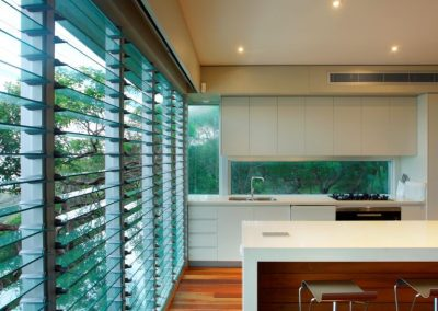 This kitchen benefits from a wall of Altair Louvres with glass blades and low profile handle.
